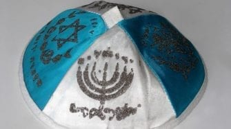 Migrant Who Attacked Kippah-Wearer Demands Compo